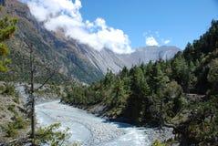 Asian landscape. Azure stream landscape in Nepal Royalty Free Stock Image