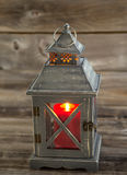 Asian Lantern and burning large red candle inside on weathered w Royalty Free Stock Photo