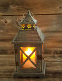 Asian Lantern and glowing white candle inside on weathered wood Stock Photos