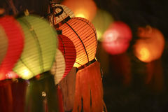 Asian lanterns. Hanging on fence Stock Photography