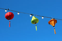 Asian Lanterns. A string of colorful Asian lanterns against a deep blue sky Stock Image