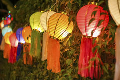 Asian lanterns on vine fence. Colorfull asian lanterns on vine fence Stock Images
