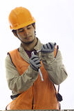 Asian latino hard hat worker Royalty Free Stock Image