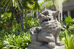 Asian Lion Statue Gate Guardian and gardens. Asian Stone Lion Gate Guardian and Gardens Royalty Free Stock Images