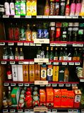 Asian liquor section in gourmet supermarket stock photography