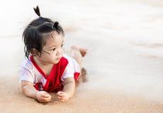 Asian little baby girl at beach Stock Photos