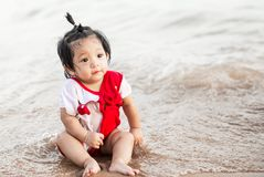 Asian little baby girl at beach Stock Images