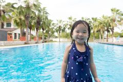 Asian little baby girl in swimming pool Royalty Free Stock Photos