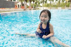 Asian little baby girl in swimming pool Royalty Free Stock Photo