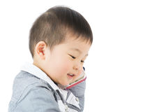 Asian little boy chatting by mobile Royalty Free Stock Photography