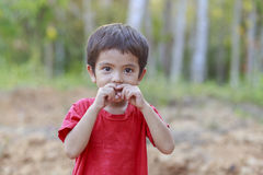 Asian little boy close his mouth Stock Photo