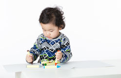 Asian little boy concentrate on drawing Royalty Free Stock Photos