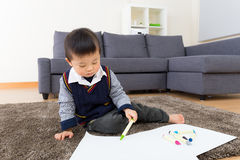 Asian little boy drawing picture Royalty Free Stock Photo