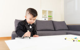 Asian little boy drawing picture Stock Images