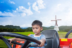 Asian little boy driver tractor on rice field Stock Photography
