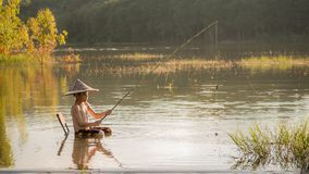 Asian little boy fishing. In a lake Stock Photography