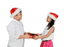 Asian little boy giving presents to his sister Stock Photo