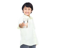 Asian Little boy holding glass of water Royalty Free Stock Photography