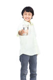 Asian Little boy holding glass of water Stock Photo