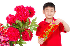 Asian Little Boy Holding Red Couplets for Chinese New Year. On White Background. Text on couplets means May you be happy and prosperous in Chinese
