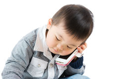 Asian little boy listen to phone Royalty Free Stock Image
