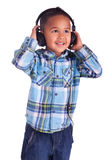 Asian little boy listening to music Royalty Free Stock Photos
