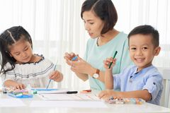 Happy children and students drawing royalty free stock image