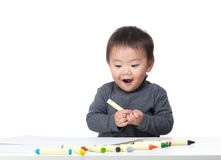 Asian little boy love drawing Royalty Free Stock Image