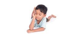Asian little boy lying on the floor Stock Image