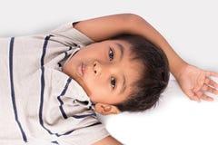Asian little boy lying on floor Royalty Free Stock Image
