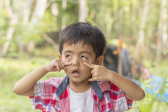 Asian little boy made a wry horrible face Stock Photo