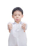 Asian little boy making thumbs down gesture with both hands. Over white background royalty free stock photography