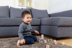 Asian little boy play wooden toy block Royalty Free Stock Photography