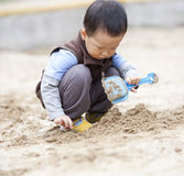 Asian little boy playing the sand Stock Image