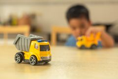 Asian Little boy is playing with toy cars at home stock photo