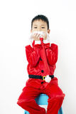 Asian little boy in red santa and red hat on white background Stock Images