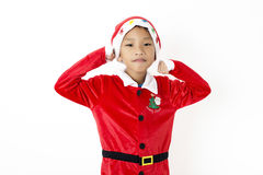 Asian little boy in red santa and red hat on white background Royalty Free Stock Photo
