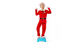 Asian little boy in red santa and red hat on white background Royalty Free Stock Photography