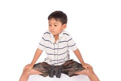 Cute asian little boy sitting on floor with binoculars. Asian little boy sitting on floor with binoculars Royalty Free Stock Photos