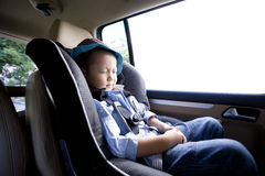 Asian little boy sleeping in the car Royalty Free Stock Image
