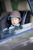 Asian little boy sleeping in the car Stock Image