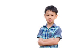 Asian little boy smiles on white background. Arms crossed Asian little boy smiles isolated on white background royalty free stock images