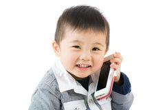 Asian little boy talk to phone Royalty Free Stock Photo