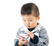 Asian little boy touching the smartphone Stock Photos