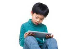 Asian little boy using tablet Stock Photography
