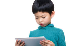 Asian little boy watching on tablet stock photo