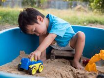 Free Asian Little Child Boy Playing Car Toy And Sand In Sandbox Outdoor Royalty Free Stock Photo - 175940685
