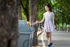 Asian Little Child Girl Hand Holding Plastic Bottle,putting Plastic Water Bottle In Recycling Bin,tourist Woman Hand Throwing Royalty Free Stock Photo