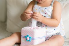 Asian little child hands pulling white tissue paper from tissue royalty free stock photos