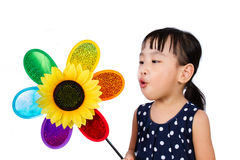 Asian Little Chinese Girl Blowing Colorful Windmill Stock Images